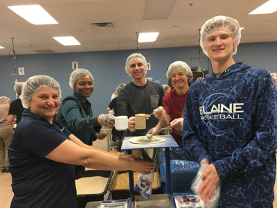 Meier Tool stamping team helping others