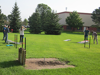 Meier Tool engineering experts playing bag toss to focus on health and productivity
